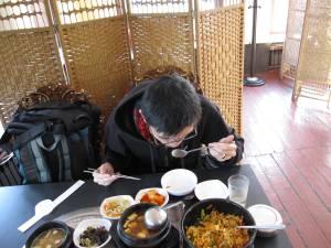 Jeff enjoying a meal of Korean food