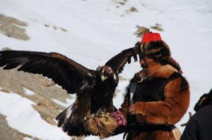 A hunter with his eagle before the festivities began.